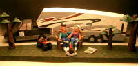 Custom made Retirement Gift...they ran a RV dealership and love the open road.....handamde trailer and pickup..the sculpture is 2 feet long
