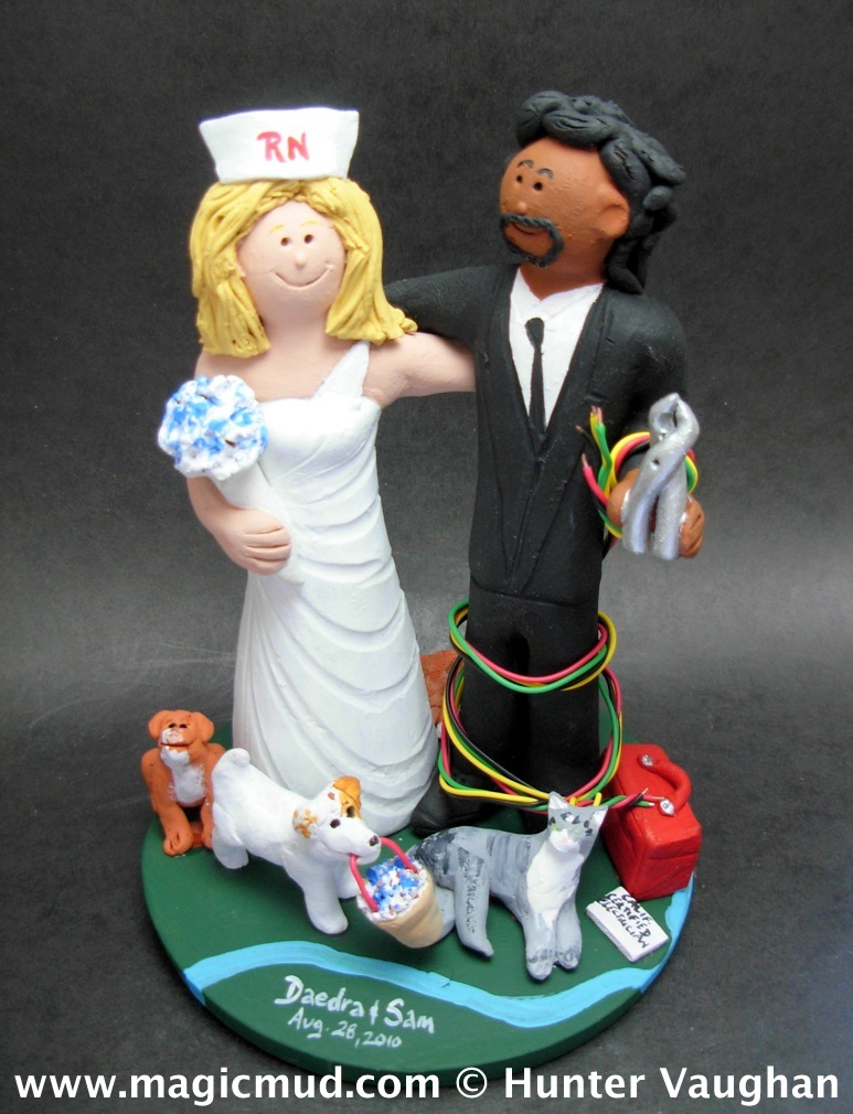 Aside! The interracial bride and groom wedding cake topper are not